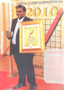 mr-jagannadham-on-the-stage-during-the-award-function-with-the-award-certificate-and-momento-that-he-received-in-banyaluka-bosnia-and-herzegovina-on-15th-dec-2010-8050